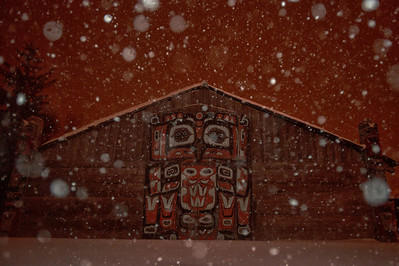 A Tlingit longhouse during a snowstorm in Fort Seward, Alaska.