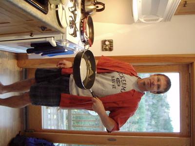 Jon cooking pancakes.
