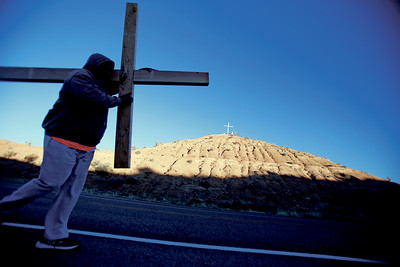 Jaime Terejo of Albuquerque, carries a cross during his pilgrimage to the Santuario de Chimayo on Good Friday, April 19, 2019. Luis Sánchez Saturno/The New Mexican