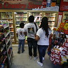 Xavier Atencio, left, 12, his brother Leroy Atencio, 14, and their mom Vanessa Martinez, all of Española, get drinks at Santa Cruz Country Store in Santa Cruz on Thursday, March 29, 2018. Martinez has done the pilgrimage 13 times and the kids only 5. Their shirts have pictures of relatives who have passed. Luis Sanchez Saturno/The New Mexican