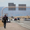 Joseph Benavidez of Santo Domingo Pueblo hikes along I-25 at the top of La Bajada on his eight year going making his pilgrimage to the Santuario de Chimayo for holy week on Wednesday, March 28, 2018. Luis Sánchez Saturno/The New Mexican
