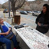 """Sofia Cisneros of Questa, NM, left, a cancer survivor, looks at rings with Joan Medina, with Lowlow's Lowrider Art Place at the Santuario de Chimayo on Monday, March 26, 2018. Cisneros attributes her cancer survival to her faith. """"The lord is the one that healed me."""" She said. """"He has a plan for us all."""" Luis Sánchez Saturno/The New Mexican"""