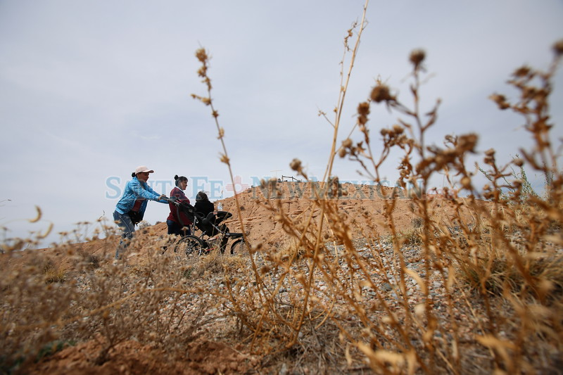 Alma Marin of Española, back, her sister Silvia Marin, and Alma's baby Nataly Ortiz, 2, make their way to the Santuario de Chimayo on Monday, March 26, 2018. Silvia is on her 12th pilgrimage in a row. Luis Sánchez Saturno/The New Mexican