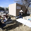 Ana Garcia, left, of Salt Lake City, UT, her boyfriend Chris Roberts, her mom Olga Cabral, and her daughter Trixie James, 10, eat snacks at the Santuario food area on Thursday, March 29, 2018. Luis Sanchez Saturno/The New Mexican