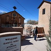 """Elizabeth Trujillo and her husband Ernest Martinez of Santa Fe, walk out of the Santo Niño de Atocha Chapel in Chimayo on Wednesday, March 28, 2018. """"We've walked but it's been probably 5 years,"""" said Trujillo about making the pilgrimage. """"But we take the easy way and drive."""" Her husband added """"we are getting to old to walk."""" Luis Sánchez Saturno/The New Mexican"""