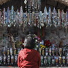 Annjanette Alejano-Steele of Morrison, CO, sits at a shrine outside the Santuario de Chimayo on Thursday, March 29, 2018. Luis Sanchez Saturno/The New Mexican