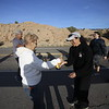 Maria Sandoval of Española gets a banana from Martha Mendoza of El Paso, TX, on their way to the Santuario de Chimayo on Thursday, March 29, 2018. Mendoza has been passing out water bananas and oranges to pilgrims for 4 years. Before that she made the pilgrimage for 15 years. Luis Sanchez Saturno/The New Mexican