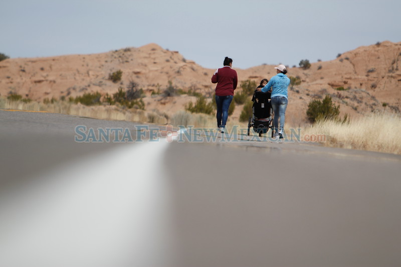 Alma Marin of Española, left, her sister Silvia Marin, and Alma's baby Nataly Ortiz, 2, make their way to the Santuario de Chimayo on Monday, March 26, 2018. Silvia is on her 12th pilgrimage in a row. Luis Sánchez Saturno/The New Mexican