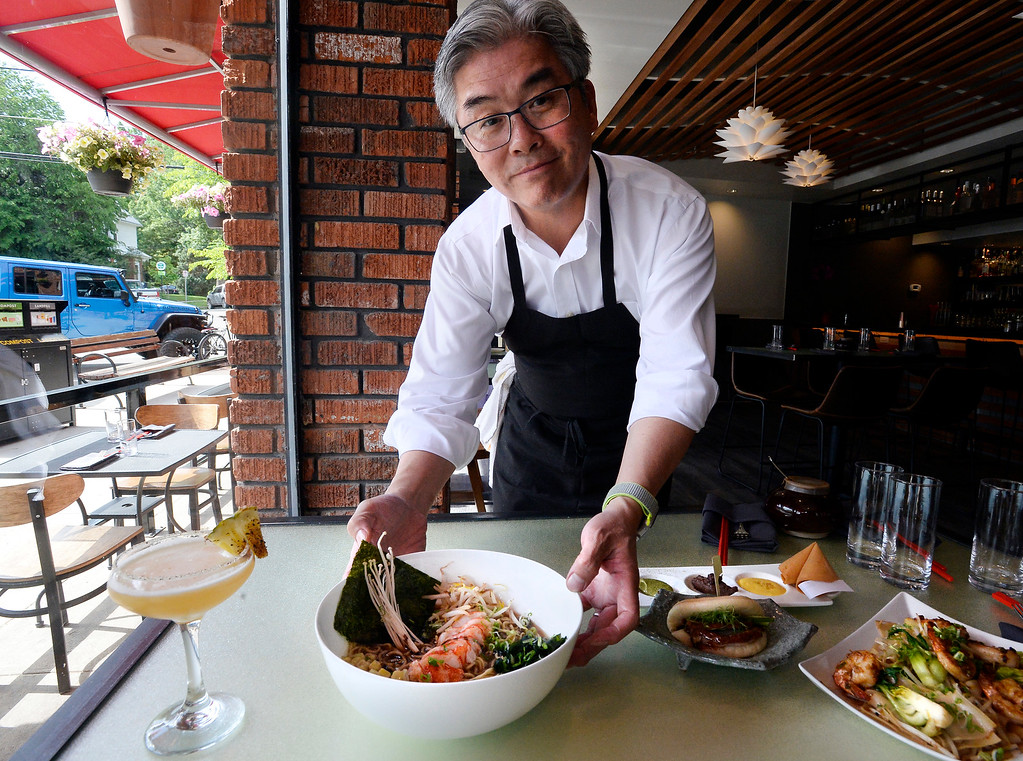 . Owner and Chef, Edwin Zoe, brings out the lobster ramen at Chimera, a new restaurant at 2014 10th Street in Boulder. Cliff Grassmick  Photographer  May 30,  2018