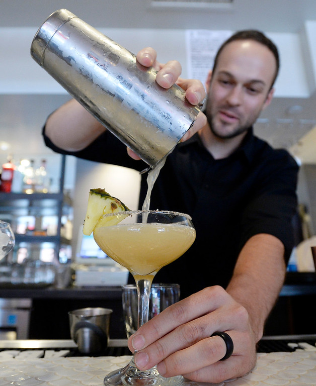. Fred Smith makes a Foo Dog drink at Chimera, a new restaurant at 2014 10th Street in Boulder. Cliff Grassmick  Photographer  May 30,  2018