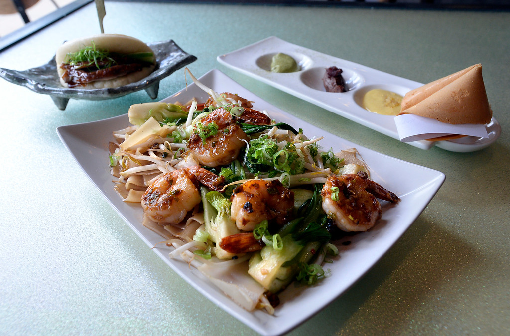 . Chow Fun with shrimp, Duck Bao, upper left, and Big Fortune Cookie, at Chimera, a new restaurant at 2014 10th Street in Boulder. Cliff Grassmick  Photographer  May 30,  2018