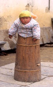 Baby in barrel warmer, Xidi, Anhui Province