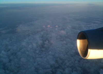 Sun touching the topcs of the clouds, somewhere over Alaska or Canada