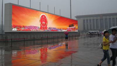 Enormous video screens on Tienanmen Square. The colors and images were very vivid on such a rainy gray day