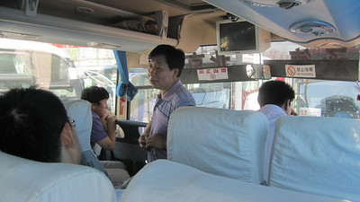 It's too long a story to tell here, but they did a complete shakedown on the bus passengers for more money after we left the bus station, then we spend another hour or so driving around Beijing while they tried to find passengers to fill the remaining seats