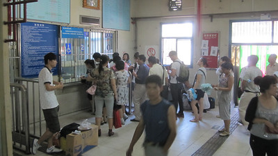 Jim in line to buy bus tickets for the trip to Chengde