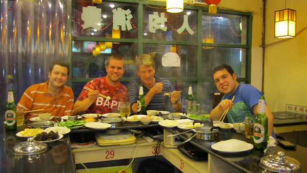 "In the ""hot pot"" restaurant near Jim's apartment. Tom, Jim, me, Steven"