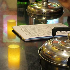 "In the ""hot pot"" restaurant near Jim's apartment"