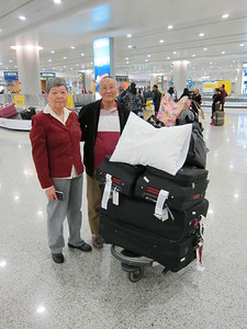 Mom and dad look great for having just survived a 16 hour flight from Chicago and from Knoxville before that! Mom snagged a pillow from the plane.