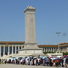 Tiananmen Square. Chinese nationals lining up to enter the Great Hall of the People. People's Hero monument in front