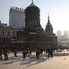Workers clear snow off the square in front of the Saint Sophia Cathedral