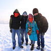 Shenzhen travel posse trying to stay warm on the Songhua River.