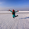 Chen Xuan jumping for joy on the Songhua River.