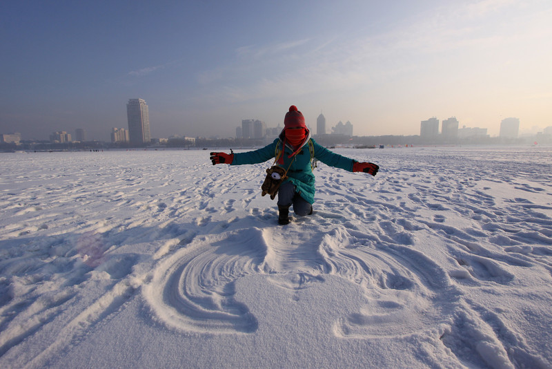 Chen Xuan in front of her first snow angel on the Songhua River.