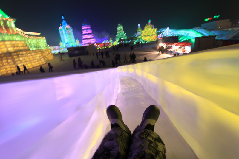Flying down a slide at the Ice and Snow Festival.