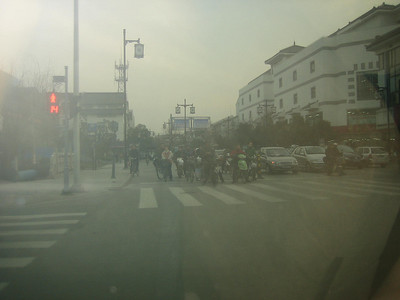 It's a little hard to see but there are as many bikes and mopeds as cars.  I would not dare drive there - scary!