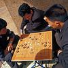 Men play Chinese checkers, Kunming