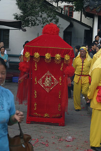 The sedan chair, to carry the bride from the boat landing to the wedding site.