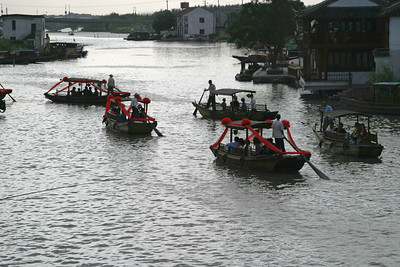 The wedding party, moving by boat to the wedding site.