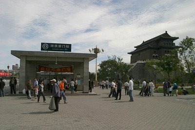 Qianmen, formally Zhengyangmen, is one of the old city gates of Beijing: the biggest, as it was located directly on the south side of Tiananmen Square, directly in line with the entrance to the Forbidden City.  It consisted of the gate proper, mounted in the city wall, and an additional archery tower on an extra semicircle of wall extending in front of the main wall and gate.  The gate and archery tower survive, but the wall was destroyed.  Visible here is the Qianmen subway station, located between the archery tower and the gate, and the back side of the archery tower at right.