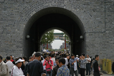 View through Qianmen gate.  Tiananmen, the front gate of the Forbidden City, is visible through the opening, almost at the horizon.