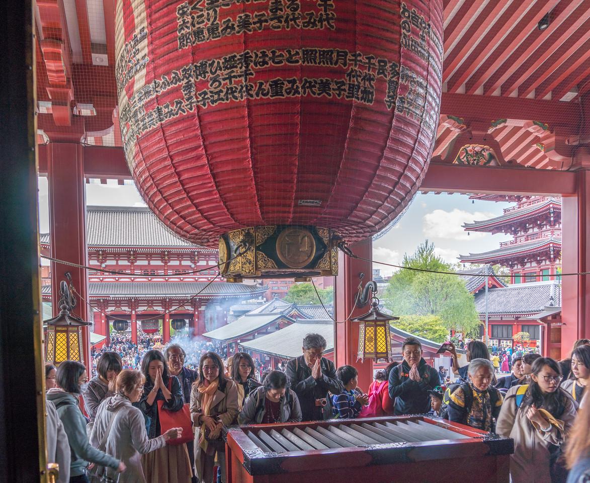 Praying at Tokyo's Senso-ji temple complex