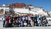 The main event of any trip to Lhasa is visiting the Potala, which was the Dalai Lama's residence.  Construction began in the 5th century, then the building was destroyed, rebuilt, and added onto many times over the centuries.  <br /> <br /> This is a photo of our group, taken in front of the Potala.  Notice that in mid-day, when the sun was intense, it was warm enough that many of us are wearing t-shirts,  yet it was cold enough at night that the water in small puddles remained frozen all day.    Also notice the blue sky - a rarity in China.