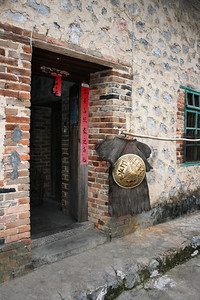 a Chinese peasant's house and her rain wear