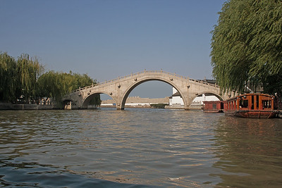a three-arched bridge in Suzhou, China