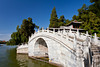 An arched bridge over a lake in Beihai Park in Beijing, China.