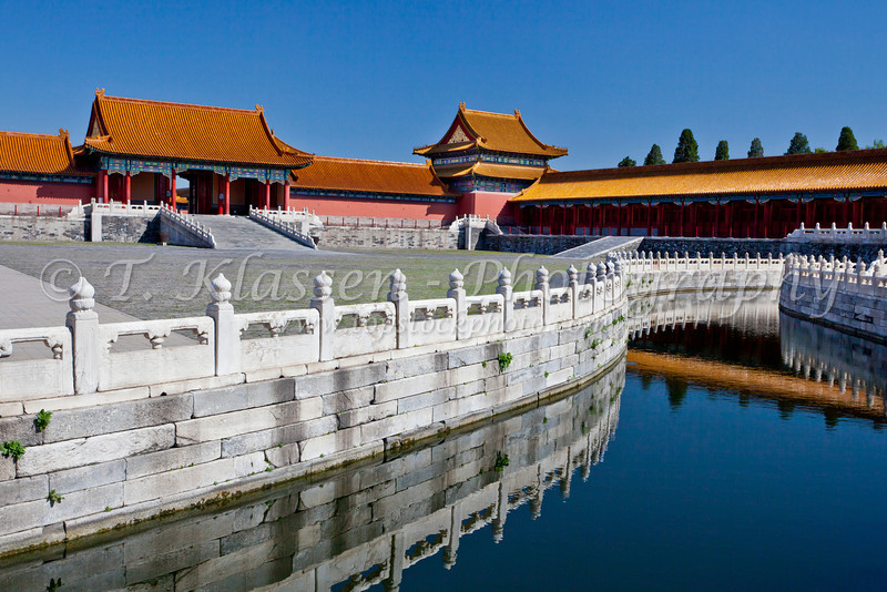 A canal with reflections in the Forbidden City, Beijing, China, Asia.