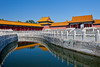 A canal with Dynasty architecture and reflections in the Forbidden City, Beijing, China, Asia.