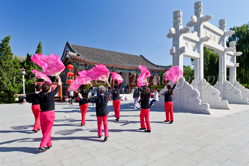 A colorful ladies dance group rehearsing in Grandview Park, Beijing, China.