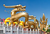 Golden dragons at the base of the Central TV Tower in Beijing, China, Asia.
