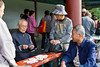 Elderly Chinese playing cards at the Temple of Heaven, Beijing, China.