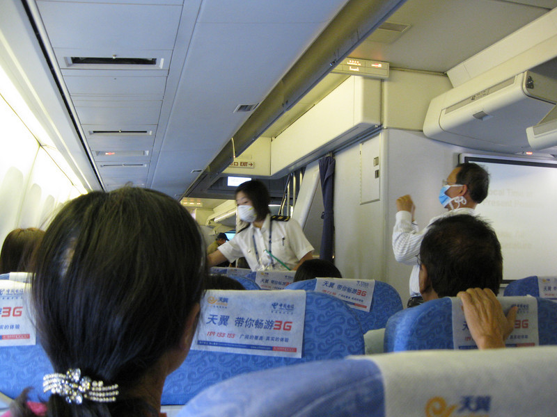 Before they let us get off the plane, a couple of quarantine officials came aboard and took everyone's temperature to check for H1N1 infection. Even the Chinese (many of whom wore masks throughout the flight) were snapping pictures!