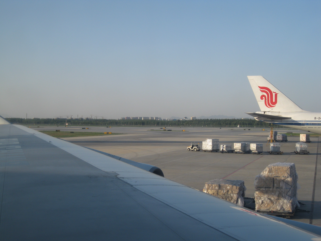 View from the tarmac at Beijing Capital International Airport. This is way clearer than I've ever seen Beijing; you can even see the mountains in the distance.