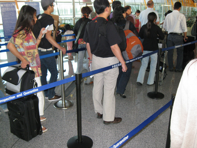 Before immigration or customs, incoming international travelers have to go through an inspection and quarantine area to check for H1N1. This line is to hand in the health information form they make everyone fill out.