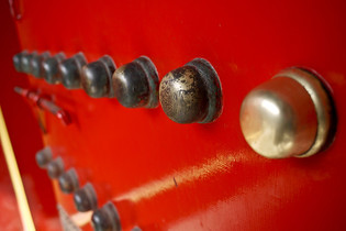 Details on the huge red doors of the Forbidden City in Beijing, China.