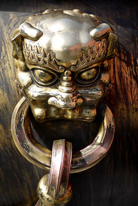 Very close look at the details and fun bronze details on a cistern at the Forbidden City in Beijing, China.